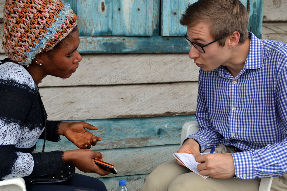 Max Bone (r), a junior studying international affairs, interviewed displaced people in Buea, Cameroon, to learn about community needs during a summer internship.