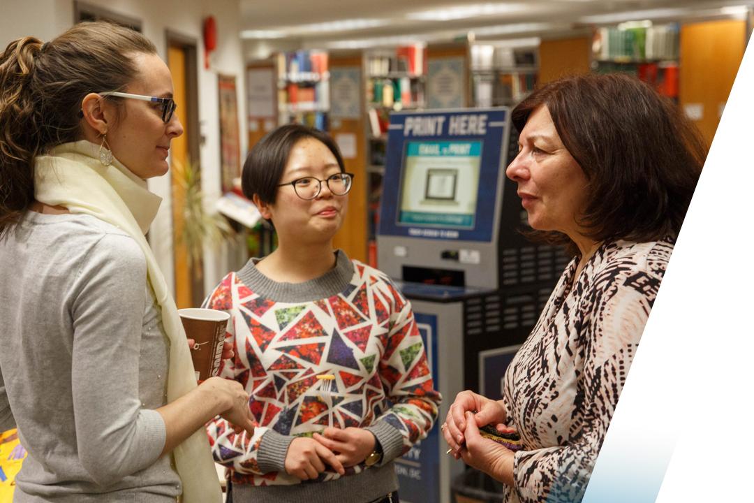 Female students talking to professor
