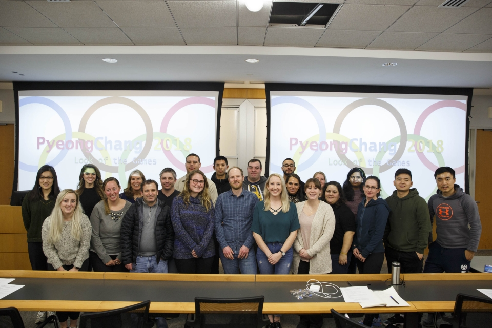 Group of students before Olympics logo
