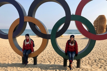 Students sitting in Olympic rings